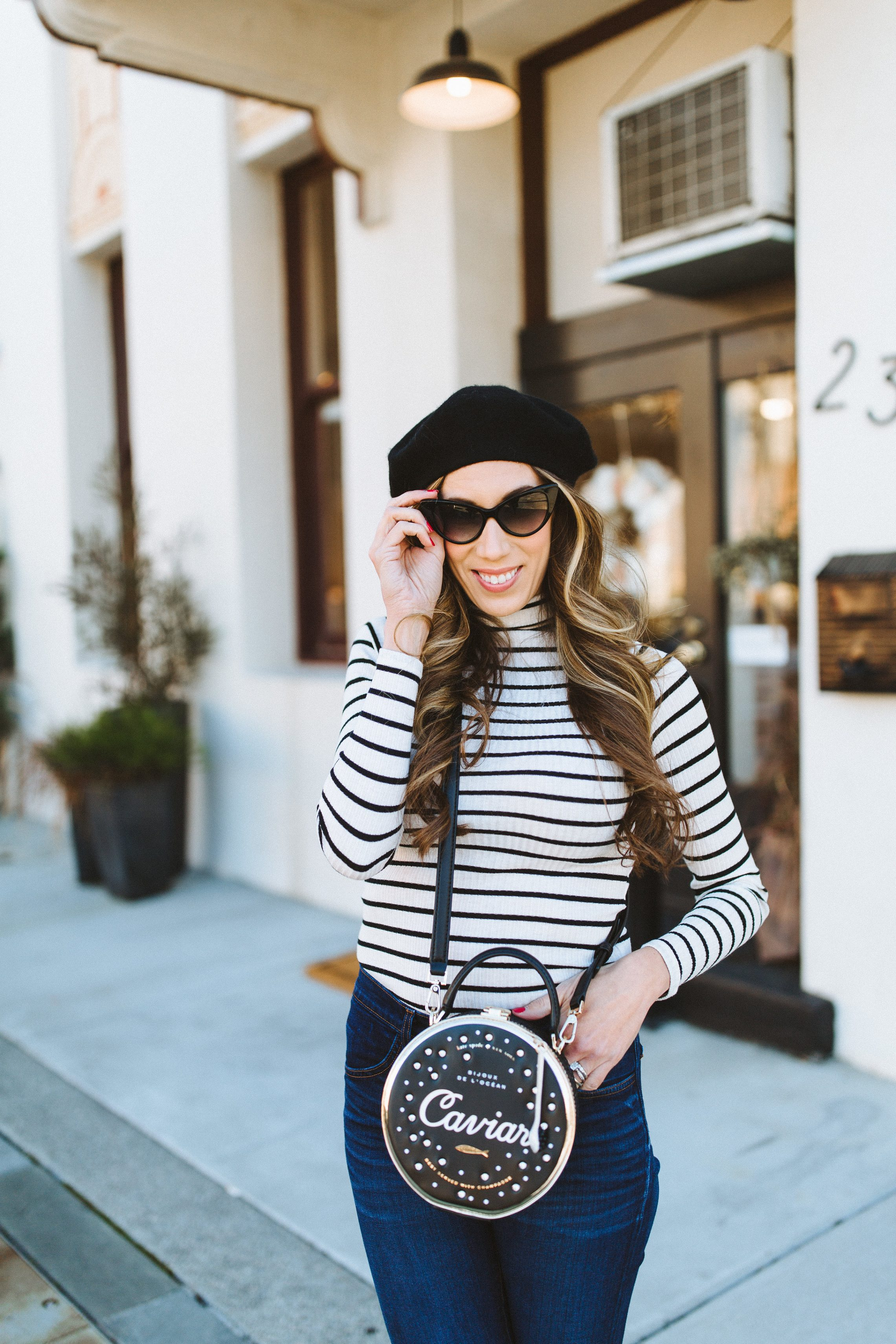 0d444fe8940b April Wagner of Champagne Colored Glasses wearing Kate Spade Finer Things  Bag